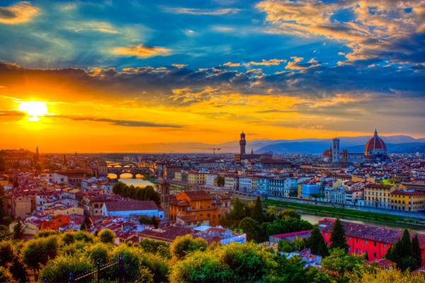 Florence seen from Michelangelo square: Arno River, Palazzo Vecchio, Duomo, beautiful sky, hills in the horizont at sunset